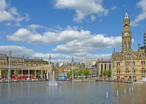 Bradford's Centenary Square and City Hall. Source https://commons.wikimedia.org/wiki/File:Bradford_(13905237800).jpg