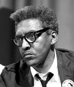 Bayard Rustin at a news briefing on the Civil Rights March on Washington in the Statler Hotel. Source: https://commons.wikimedia.org/wiki/File:BayardRustinAug1963-LibraryOfCongress_crop.jpg