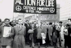 Bertrand Russell, his wife Edith Russell [https://en.wikipedia.org/wiki/Edith_Finch_Russell], and Ralph Schoenman [https://en.wikipedia.org/wiki/Ralph_Schoenman], leading an anti-nuclear march organised by the Committee of 100 in February 1961. Michael Randle can be seen second from the left. Source: https://commons.wikimedia.org/wiki/File:Bertrand_Russell_leads_anti-nuclear_march_in_London,_Feb_1961.jpg