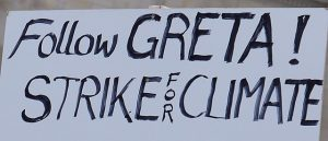 Follow Greta - strike for climate. Source [https://commons.wikimedia.org/wiki/File:Follow_Greta!_Strike_for_climate,_placard,_2018_(cropped).jpg]